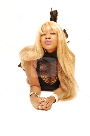 Young Jamaican girl  stock photo, An busty young Jamaican girl in a black top and brown skirt, long blond hair  lying on the floor in an studio for white background. by Horst Petzold