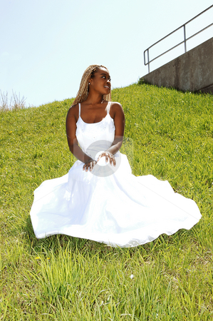 The bride sitting on the grass. stock photo, A young Jamaican bride sitting on the grass for a nice photo shoot. by Horst Petzold