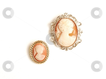 Antique cameo brooch. stock photo, Two cameo brooch with silver around, beige and orange on white background. by Horst Petzold