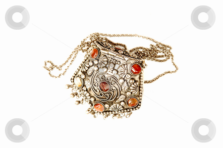 Turkish jewelry. stock photo, A beautiful handmade silver money purse with 6 red stones on top. by Horst Petzold