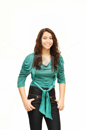 Young smiling girl. stock photo, A young girl in jeans and turquoise sweater. by Horst Petzold