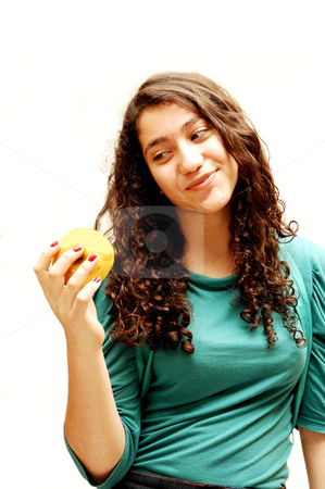 Young girl and apple. stock photo, A pretty lady whit an green apple for her diet. by Horst Petzold