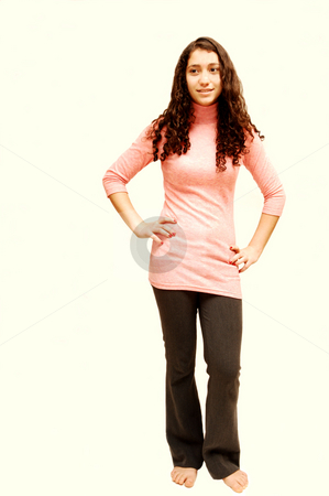 Young girl in ping sweater. stock photo, A young girl is standing  in the studio and waiting for the shoot. by Horst Petzold