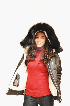 Young Lady. stock photo, A young girl in jeans and red sweater with an winter coat on. by Horst Petzold