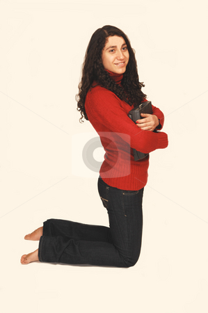 Young Lady. stock photo, A young girl in jeans and red sweater holding her laptop. by Horst Petzold