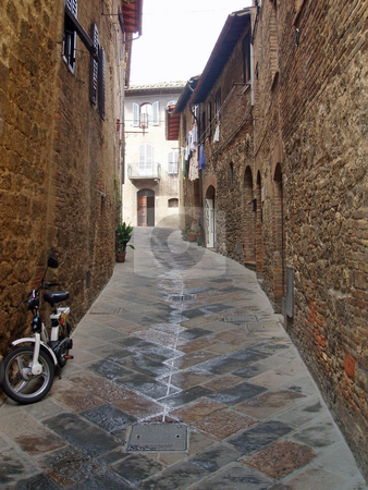 Passageway in Tuscany stock photo, Passageway and bike in Tuscany Italy by Jaime Pharr