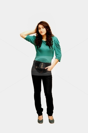 Young Lady standing. stock photo, A young girl in jeans and turquoise sweater. by Horst Petzold