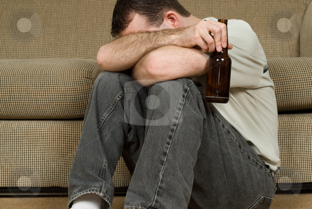 Drunk stock photo, A depressed man coping with his depression by drinking alcohol by Richard Nelson