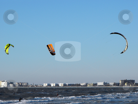 Kite boarding stock photo, Kite boarders ride the late afternoon wind along the Gulf Coast by St. Pete's Beach in Florida on a winter day. by Dennis Thomsen