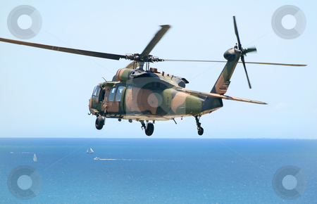Army Blackhawk stock photo, Australian Army Blackhawk chopper flies over the Pacific Ocean. by Brett Mulcahy