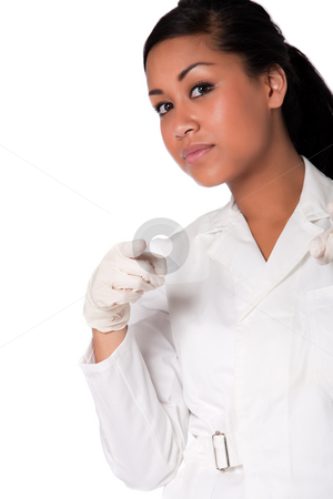Portrait of a beautifull Indonesian nurse pointing her finger stock photo, Beautifull Indonesian nurse in white uniform by Frenk and Danielle Kaufmann