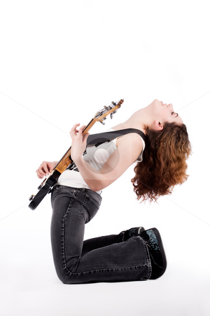Rocking on profile stock photo, Young female bass guitar player specially isolated on white by Frenk and Danielle Kaufmann
