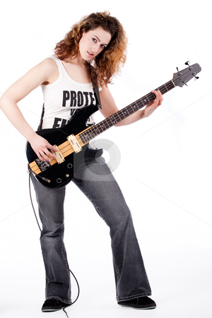 Sexy guitar player stock photo, Young female bass guitar player specially isolated on white by Frenk and Danielle Kaufmann
