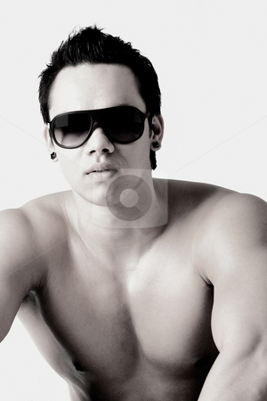 Portrait of a well build bare Indonesian man  with sunglasses stock photo, Portrait of a naked indonesian man by Frenk and Danielle Kaufmann