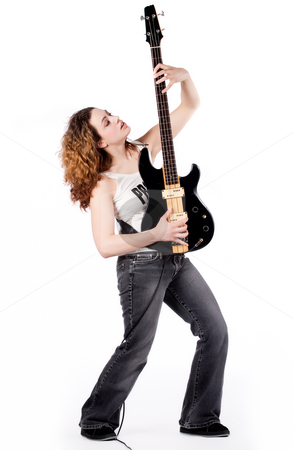 Put my guitar up stock photo, Young female bass guitar player specially isolated on white by Frenk and Danielle Kaufmann
