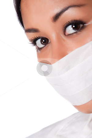 Portrait of a beautifull Indonesian nurse with mouthcap stock photo, Beautifull Indonesian nurse in white uniform by Frenk and Danielle Kaufmann