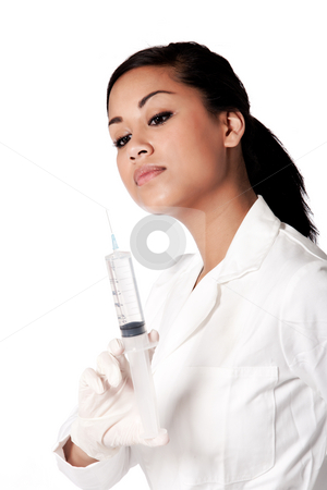 Beautifull Indonesian nurse checking her serenge stock photo, Beautifull Indonesian nurse in white uniform by Frenk and Danielle Kaufmann