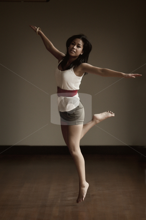 Portrait of an Indonesian girl jumping stock photo, Jumping and dancing beautifull Indonesian girl by Frenk and Danielle Kaufmann
