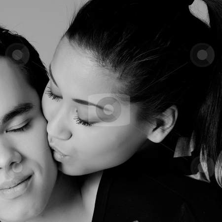 Kissing my Indonesian lover on the cheek stock photo, Portrait of Indonesian boy- and girlfriend in love by Frenk and Danielle Kaufmann