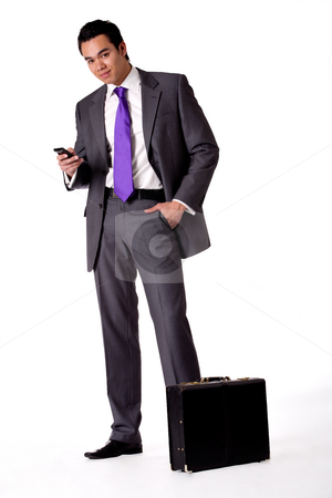 Portrait of a strong young indonesian man in a suit with phone stock photo, Business portrait of a strong indonesian man by Frenk and Danielle Kaufmann
