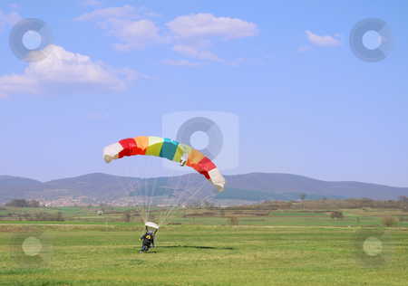 Parachutist landing stock photo, Parachutist landed on a field after good flight. by Ivan Paunovic
