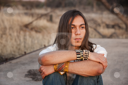 Handsome Young Man stock photo, Handsome young man with long hair in an outdoor setting by Scott Griessel