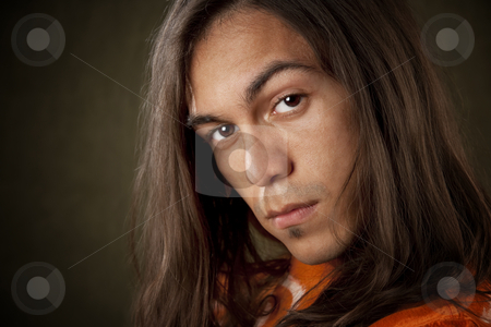 Handsome Young Man stock photo, Closeup Portrait of a Handsome Young Man with Long Hair by Scott Griessel