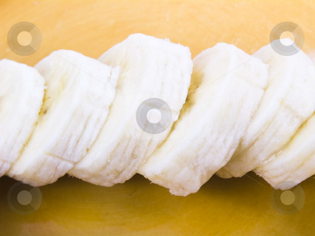 Sliced Banana stock photo, Sliced banana on a yellow plate by John Teeter