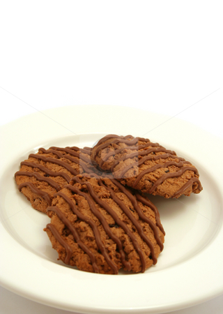 Chocolate Fudge Cookies 2 stock photo, Three chocolate fudge cookies on a white china plate - vertical format with shallow depth of field by Helen Shorey