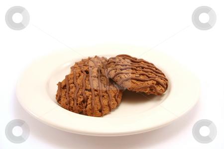Chocolate Fudge Cookies 3 stock photo, Three tasty chocolate fudge cookies on a white china plate, selective focus by Helen Shorey