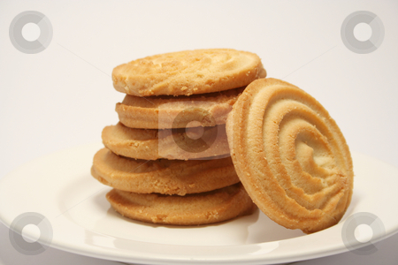 Fallen Shortbread stock photo, Stack of shortbread biscuits with one fallen off. On a neutral background and cream china plate by Helen Shorey