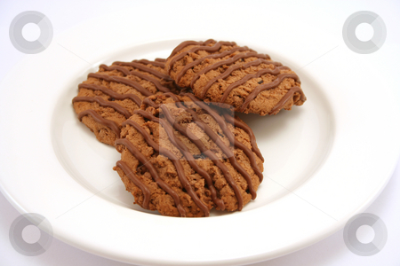Chocolate Fudge Cookies 1 stock photo, Three chocolate fudge cookies on a white plate by Helen Shorey