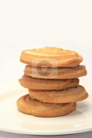 Shortbread stacked stock photo, 5 piece of sweet shortbread stacked on a cream china plate with a neutral background by Helen Shorey