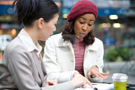 Business Meeting in the City stock photo, Two business women having a casual meeting or discussion in the city. Shallow depth of field. by Todd Arena