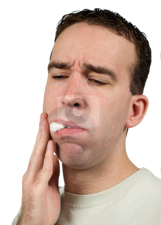 Cavity stock photo, Closeup of a young man with some cotton in his mouth to help ease the pain of a cavity, isolated against a white background by Richard Nelson