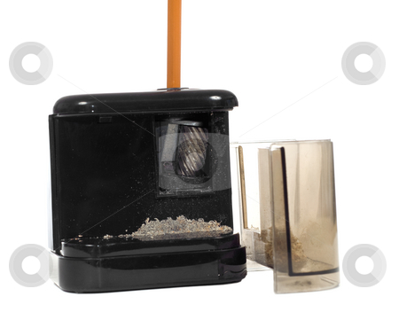 Sharpening Pencil stock photo, A pencil being sharpened in an electric sharpener, with shavings , isolated against a white background by Richard Nelson