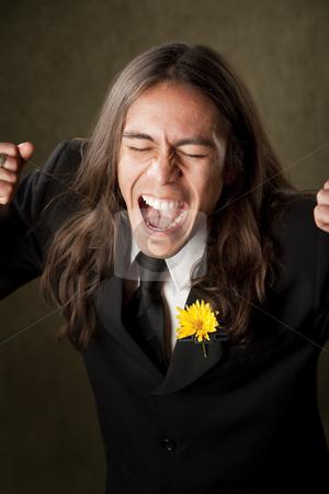 Handsome man in formalwear screaming stock photo, Handsome man screaming in formal jacket with boutonniere by Scott Griessel