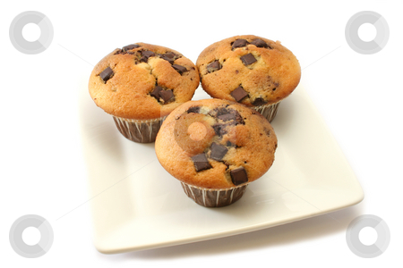 Orange and Choc Chip Muffins stock photo, Orange and chocolate flavoured muffins with choc chip pieces by Helen Shorey