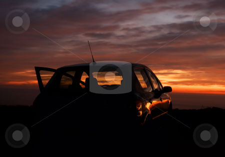 Car and the sunset in the background stock photo, Car silhouette in the sunset by Vladimir Koletic