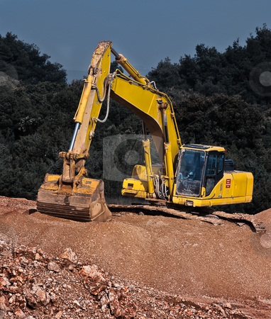 Industrial gravel and  excavator stock photo, Excavator positioned on the gravel piled-up workplace by Vladimir Koletic
