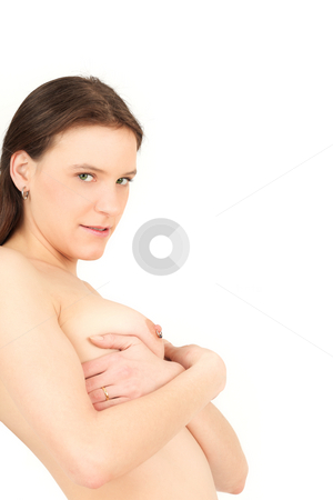 Young woman hiding her breasts stock photo, Young woman ashamed isolated on white backgroung by Tom P.