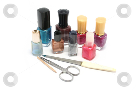 Small selection of nail polishes stock photo, Small selection of nail polishes/varnishes and manicure kit by Helen Shorey