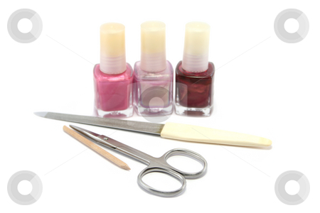 Ready to Manicure stock photo, Choice of pretty pinks and purple nail colours and a manicure set. Focus is on the scissors by Helen Shorey