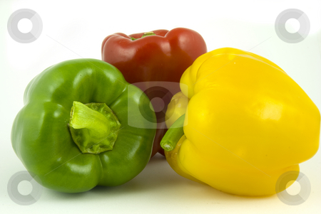 Three bell peppers  stock photo, Yellow and green and red bell peppers isolated on white background by Gert-Jan Kappert