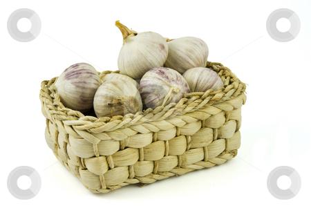 Basket full of fresh garlics stock photo, Basket full of fresh garlics isolated on white background by Gert-Jan Kappert