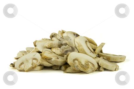 Sliced champignon mushrooms stock photo, A pile of sliced champignon mushrooms isolated on white background. by Gert-Jan Kappert