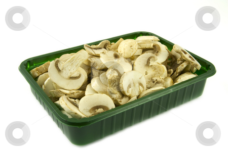 Sliced champignon mushrooms in green pack stock photo, Sliced champignon mushrooms in green pack isolated on white background by Gert-Jan Kappert