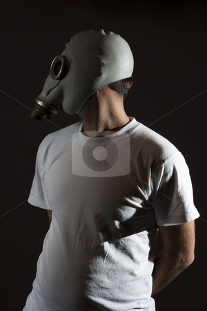 Gas mask danger  stock photo, A man wearing a gas mask environment danger concept image by Ivan Montero