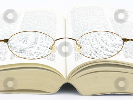 Visione stock photo, Eye glasses over book improving vision to see better by John Teeter
