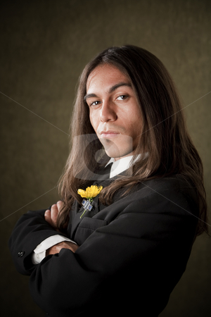 Handsome man in formalwear stock photo, Handsome man in formal jacket with boutonniere by Scott Griessel